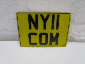 NY11COM-car-number-plate